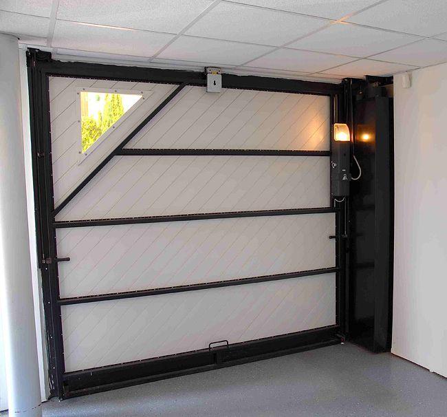 Motorisation de portes de garage alsace eurosyst mes - Porte de garage basculante debordante ...
